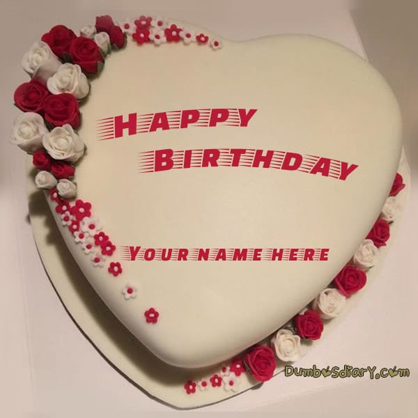 Beige color heart shaped birthday cake