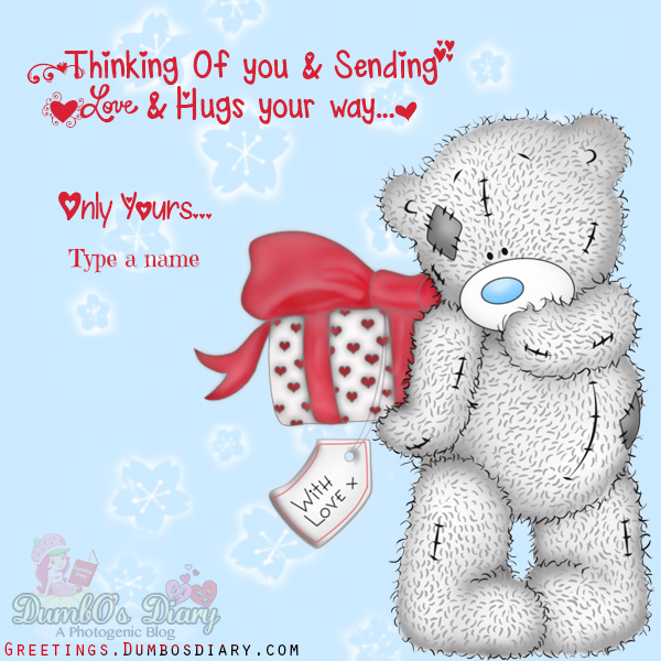 Tatty Teddy Holding Gift